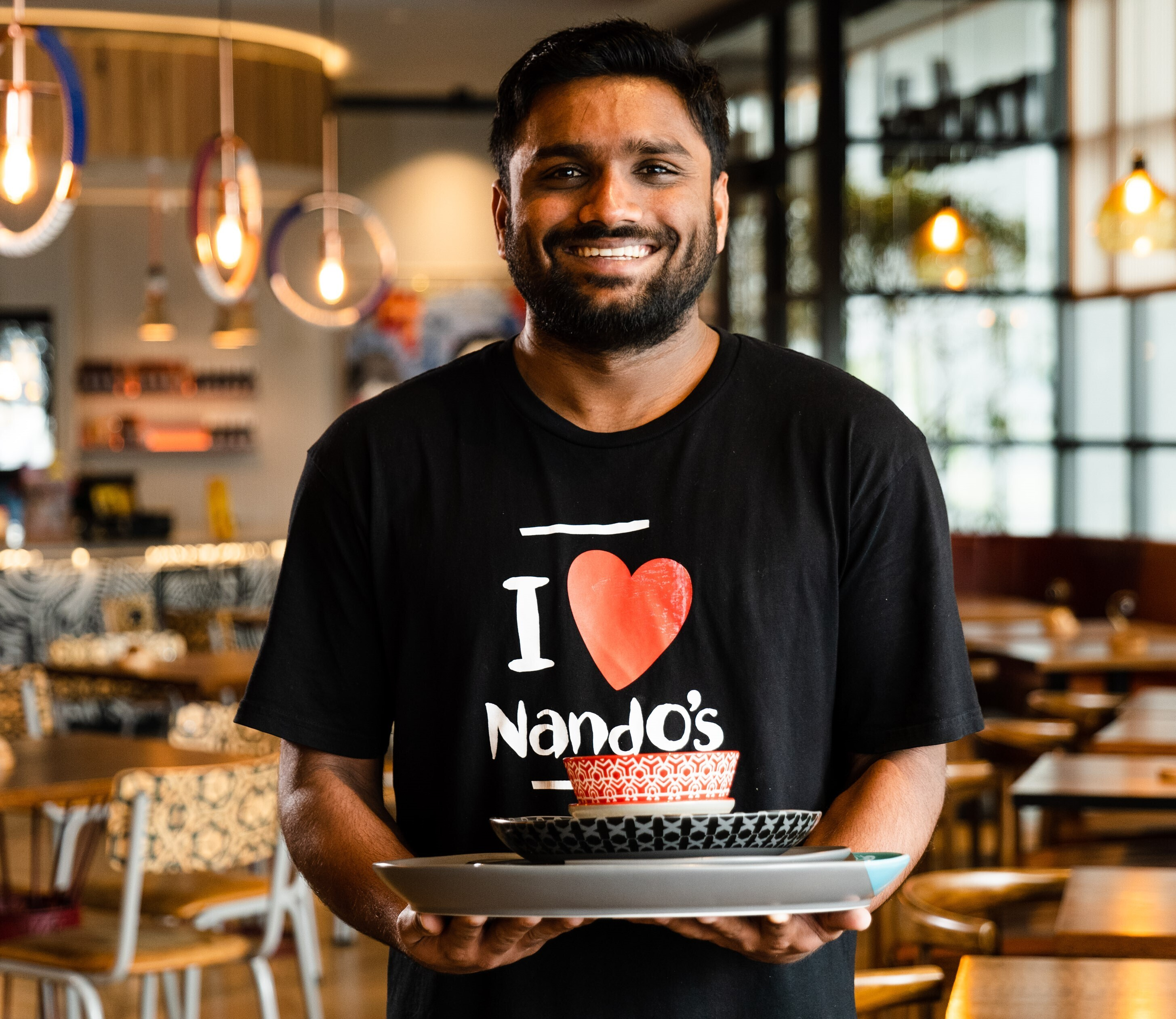 Picture of Nando's staff member smiling