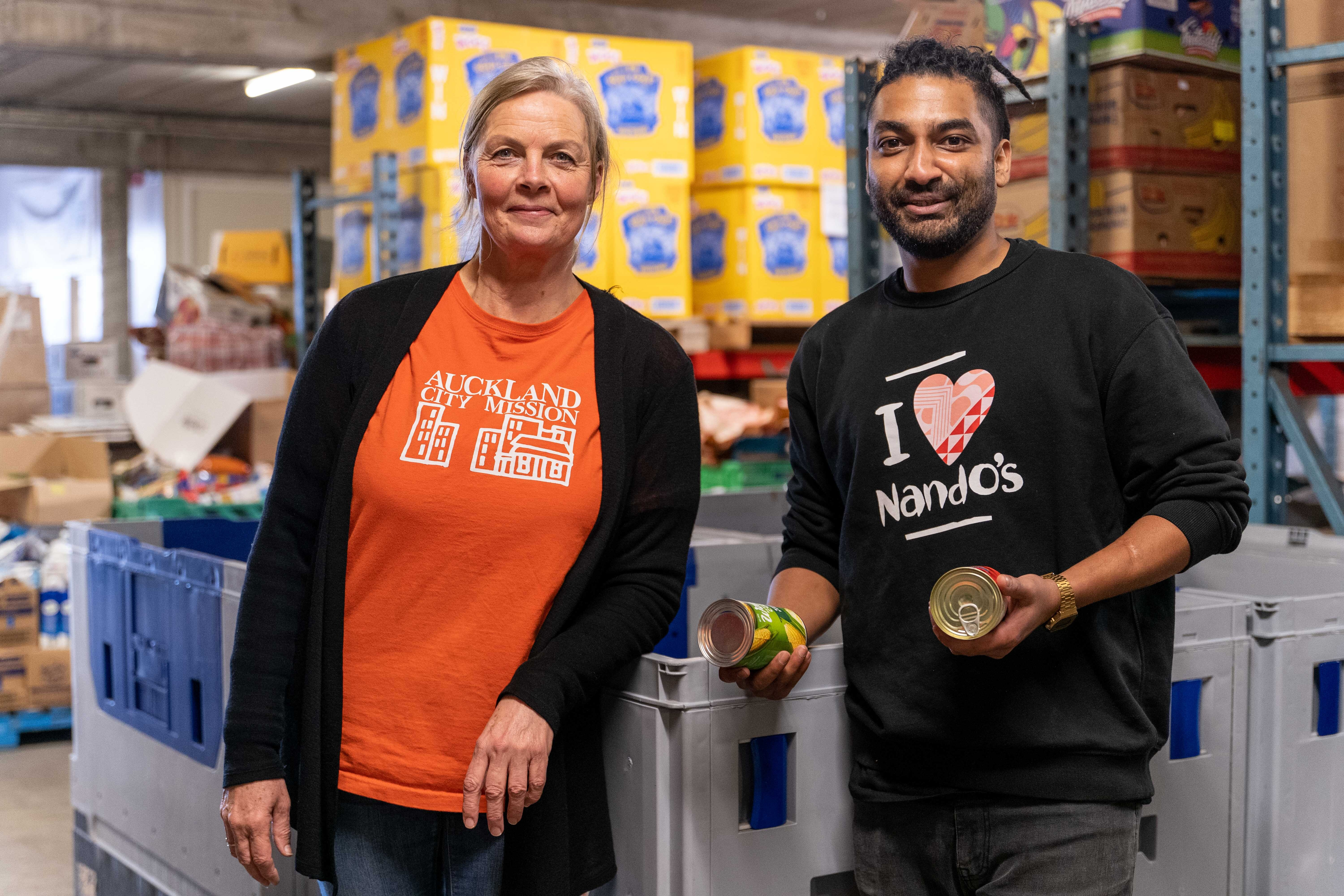 Auckland City Mission staff member and Nando's staff member at the Mission's distribution centre.